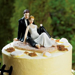 Romantic Wedding Couple Lounging on the Beach Figurine