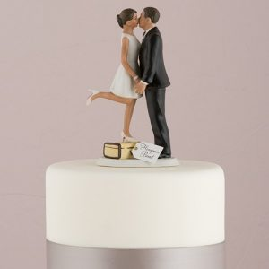 A Kiss and We're Off Cake Topper